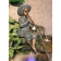 Boy figure playing flute garden statue